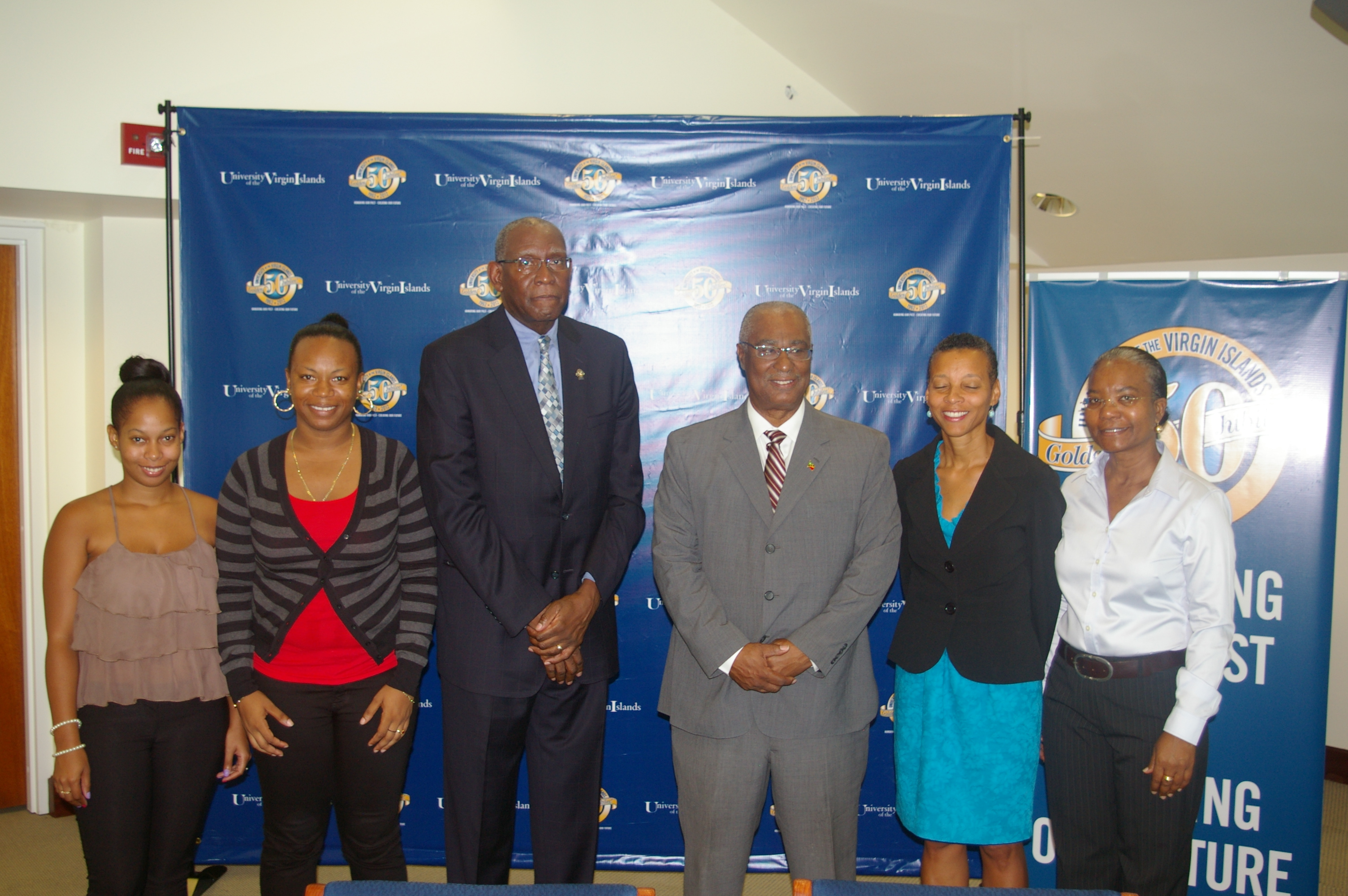 (L-R) UVI students-Ms.Abigail Parry and Ms Aujeunelle Brown, UVI President- Mr. David Hall, Premier of Nevis, Hon. Joseph Parry and UVI staff members.
