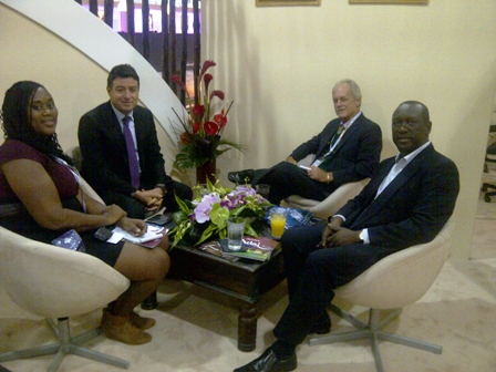 St. Kitts and Nevis Tourism Officials (left) Chairman of the Board of the Nevis Tourism Authority Ms. Keisha Jones, (third from right) Advisor to Tourism in the Nevis Island Administration Mr. Alastair Yearwood and (right) Chairman of the Board of Directors of the St. Kitts Tourism Authority Mr. Alfonso O'Garro at a meeting with a potential Dubai investor (middle) on November 07, 2012, at the World Travel Market 2012 in London