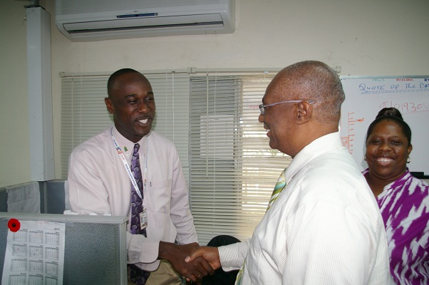 Premier Parry shaking hands with Mr. Keeton Jones, Brown Hill Communications staff