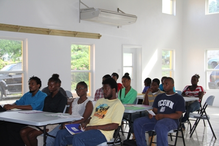 Participants at the Creativity for Employment and Business Opportunity Youth Training Workshop with a facilitator Mr. Irvin Welsh seated on the extreme left