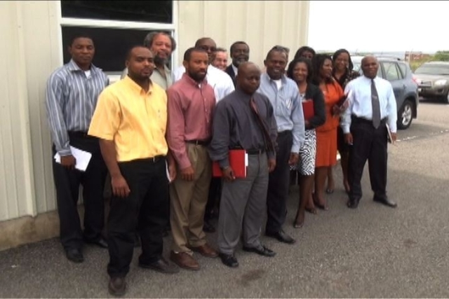 Participants of the Caribbean Energy Week 2012 activity on November 20th outside the Llewellyn Newton Disaster Management Facility at Long Point