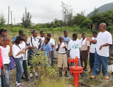 Geothermal Coordinator in the Nevis Island Administration Mr. Pearlivan Wilkin (right) conducting a visit to the Geothermal Site at Spring Hill, Nevis with a mixed group of students from St. Kitts and Nevis during Caricom Energy Week 2011