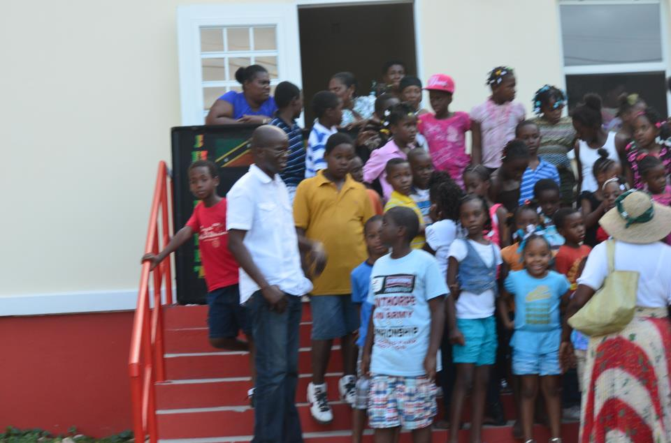 Attorney General, Hon. Patrice Nisbett and children enjoying the Christmas party in St. James Parish
