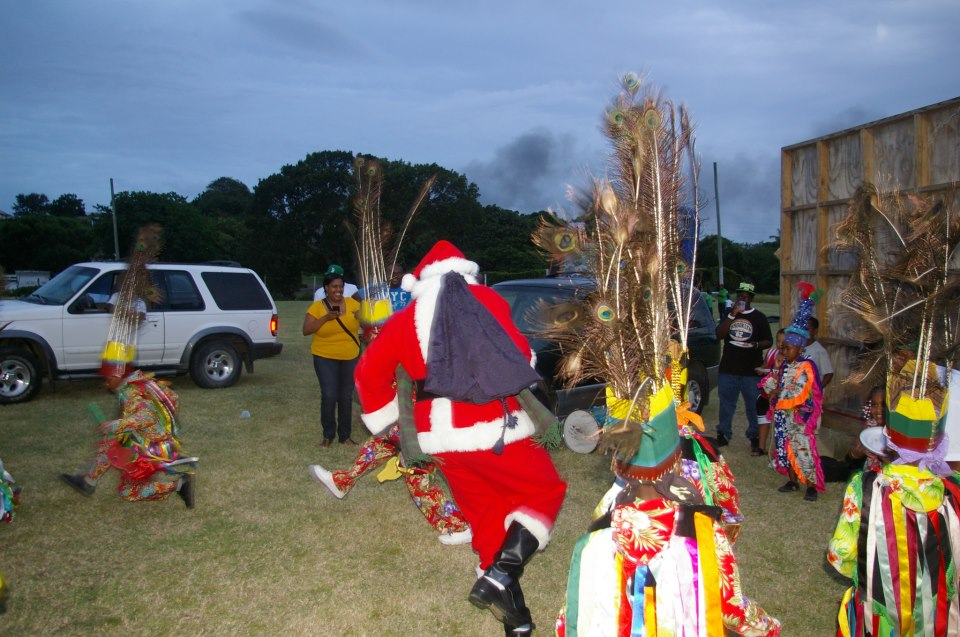 Santa Claus dancing with masqueraders