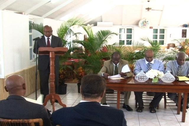 Permanent Secretary in the Ministry of Finance on Nevis Mr. Laurie Lawrence at the podium with (l-r) Attorney General of St. Kitts and Nevis Hon. Patrice Nisbett, Premier of Nevis Hon. Joseph Parry and Legal Advisor in the Nevis Island Administration Mr. Herman Liburd at the head table during the launching ceremony of the New Revised Laws of St. Christopher and Nevis (Nevis Ordinance) at Hamilton House in Charlestown