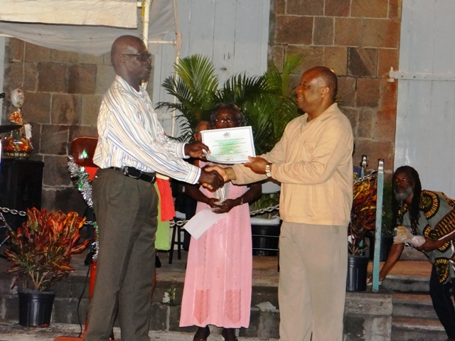 Advisor to the Premier of Nevis Mr. Hensley Daniel presents Certificate of Recognition from the Department of Community Development to honouree in the St. Georges Parish Mr. Miguel Mills