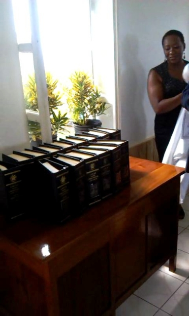 The unveiled New Revised Edition of the Laws of Saint Christopher and Nevis (Nevis Ordinances). Senior Legal Counsel at the Nevis Island Administration's Legal Department Ms. Shemika Maloney looks on moments after the unveiling