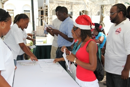 Young persons making inquiries about the People Empowerment Programme moments after the programme was launched on Nevis