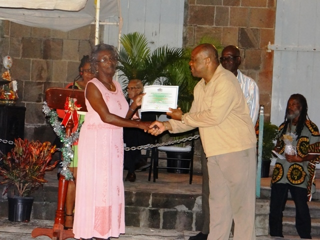 Advisor to the Premier of Nevis Mr. Hensley Daniel presents Certificate of Recognition from the Department of Community Development to honouree in the St. James parish Mrs. Eileen Weekes Walwyn