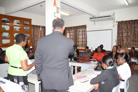 Minister of Education and Premier of Nevis Hon. Vance Amory visits with Grade 2 teachers attending a reading workshop while at the Ministry of Education at Marion Heights