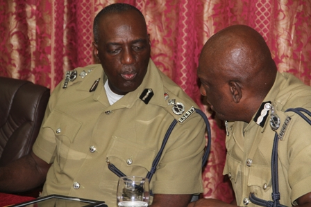 (L-R) Commissioner of the Royal St. Christopher and Nevis Police Force Celvin Walwyn and Assistant Commissioner of Police, Nevis Division Robert Liburd discuss during the annual New Year's Blessing ceremony on January 4, 2013, at the Divisional Headquarters in Charlestown