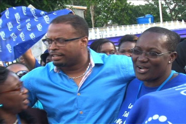 Deputy Leader of the Concerned Citizens Movement Mr. Mark Brantley celebrates his victory at the polls with elated supporters outside party headquarters in Charlestown