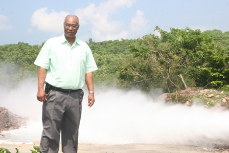 Hon. Joseph Parry during a visit to geothermal well in 2008 with proof of geothermal energy in the background at Spring Hill (file photo)