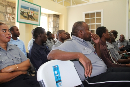 Police Officers listen attentively during the Royal St. Christopher and Nevis Police Force, Nevis Division's New Year's Blessings ceremony at the Headquarters in Charlestown