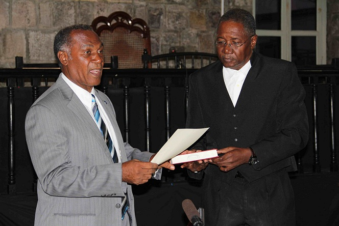 New Premier of Nevis Hon. Vance Winkworth Amory takes Oath of Allegiance administered by Resident Judge at the High Court in Charlestown late Wednesday January 23, 2013