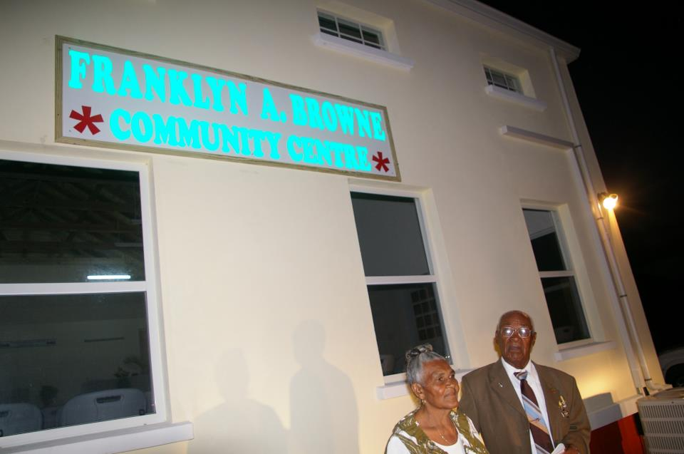 Mr. Franklin A. Browne and his wife Lorraine in front of the newly named community center