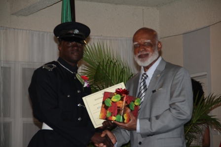 Third runner up for title of Constable of the Year in the Royal St. Christopher and Nevis Police Force Constable #755 Derell Boon of the Gingerland Police Station receiving his recognition gift from Governor General of St. Kitts and Nevis His Excellency Edmund Lawrence