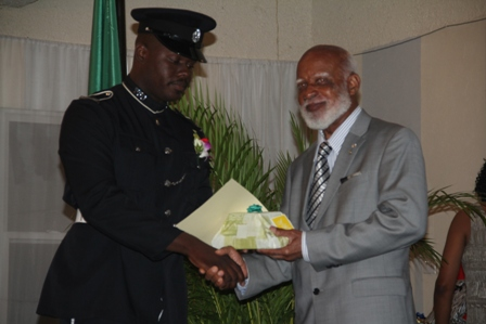 Second runner up for title of Constable of the Year in the Royal St. Christopher and Nevis Police Force Constable #750 Kishorn Charles of the Criminal Investigation Department receiving his recognition gift from Governor General of St. Kitts and Nevis His Excellency Edmund Lawrence