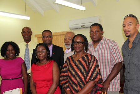 Newly installed Board of Directors for the Nevis Cultural Development Foundation with Deputy Premier and Minister of Culture in the Nevis Island Administration Hon. Mark Brantley (back row second from left) moments after their installatio. (L-R back row) Mr. Abdul Karim Ahmed, Mr. Amba Trott, Mr. Marcus Hull and Mr. Patrick Howell. (L-R front row) Board Chairperson Mrs. Jeanette Maloney, Ms. Elmeader Brookes and Board Secretary Mrs. Jacqueline Jeffers