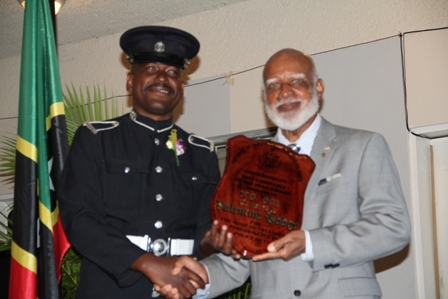 Top Constable of the Royal St. Christopher and Nevis Police Force, Nevis Division #601 Valentine Hodge receiving his recognition plaque from Governor General of St. Kitts and Nevis His Excellency Edmund Lawrence