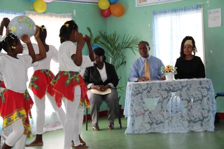 "Premier of Nevis and Minister of Education enjoying a production of ""We are the World"" by students of the Violet O. Jeffers Nicholls Primary School's Inaugural Induction Ceremony for their School Safety Patrol programme. Sitting to his left is the school's principal Mrs. Shea Swanston-Wilkin and to his right Education Planner at the Department of Education Dr. Neva Pemberton"