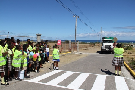 Newly inducted crossing guards on duty on the pedestrian crossing outside the as part of the Violet O. Jeffers Nicholls Primary School's School Safety Patrol programme