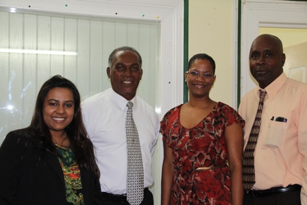 (L-R) Manager of International Admissions, Munroe College based in New York Ms. Krystle Dookoo, Premier of Nevis and Minister of Education Hon. Vance Amory, Director of Admissions at the College Mrs. Keija Nichol based at the Munro Collage St. Lucia Campus and Cabinet Secretary Mr. Stedmond Tross