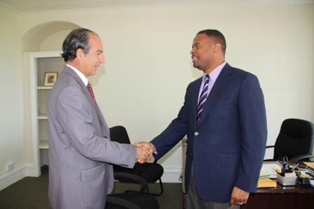 Leader of the Opposition in the Federal Parliament Hon. Mark Brantley (l), who is also the Deputy Premier of Nevis and Minister of Tourism in the Nevis Island Administration, meets with Ambassador from the Republic of Chile to St. Kitts and Nevis His Excellency Eduardo Bonilla Menchaca at his Bath Hotel office