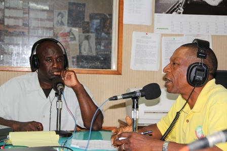 "(l) Senior Extension Officer in the Department of Agriculture on Nevis Mr. Walcott James discussing the Department's annual Agriculture Open Day with (r) Minister of Agriculture in the Nevis Island Administration and host of ""On the Mark"" programme at VON Radio and Hon. Alexis Jeffers"