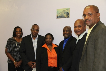 "Minister of Housing and Lands in the Nevis Island Administration and Chairman of the Nevis Housing and Land Development Corporation Board of Directors Hon. Alexis Jeffers (third from right) with fellow members (L-R) Ms. Melissa Seabrookes, Board Secretary Mr. Oscar ""Astro"" Browne Ms. Juletta Jeffers, Mr. Leon Lescott and Dr. Cardell ""Bal"" Rawlins"