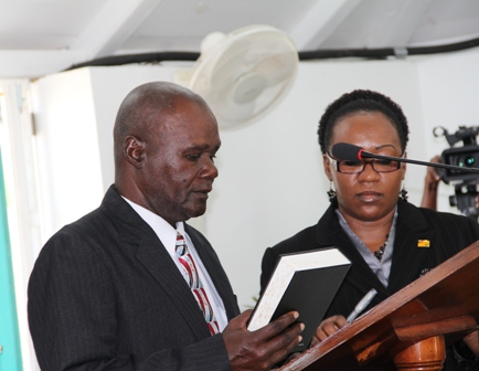 New President of the Nevis Island Assembly Hon. Farrel Smithen takes his oath at the Nevis Island Assembly Chambers at Hamilton House on March 26, 2013