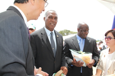 Premier of Nevis Hon. Vance Amory (second from left) and Minister of Agriculture Hon. Alexis Jeffers (second from right) visit the display booth of the Republic of China (Taiwan)'s Agricultural Mission with Ambassador of the Republic of China (Taiwan) to St. Kitts and Nevis His Excellency Miguel Li-Jey Tsao (extreme left) at the 19th annual Agriculture Open Day at the Villa Grounds in Charlestown hosted by the Department of Agriculture on March 21, 2013