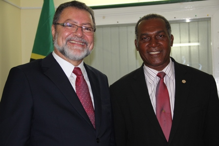 Premier of Nevis Hon. Vance Amory (r) and Brazilian Ambassador to St. Kitts and Nevis based in Basseterre His Excellency Antonio Jose Rezende de Castro at the Premier's Bath Hotel Office