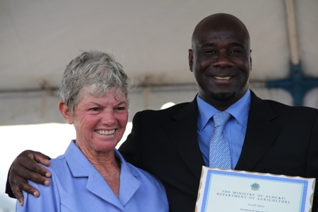 Minister of Agriculture on Nevis Hon. Alexis Jeffers presents an appreciation plaque on behalf of the Ministry and Department of Agriculture, to Patron of the 2013 Agriculture Open Day Mrs. Sandra David