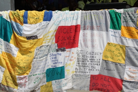 Some messages against violence from voices across Nevis on the 50 foot quilt