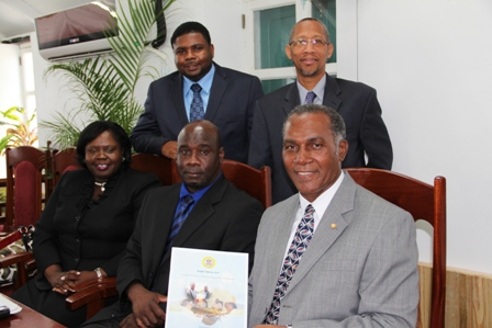 Premier of Nevis and Minister of Finance Hon. Vance Amory (front row extreme right) holds a hard copy of the Nevis Island Administration's 2013 Budget Address, moments after he delivered it at the Nevis Island Assembly on April 26, 2013 with (L-R front row) Hon. Hazel Brandy-Williams, Hon. Alexis Jeffers (back row) Hon. Troy Liburd and Legal Advisor Mr. Colin Tyrell