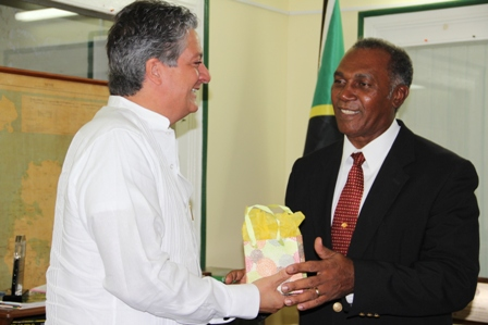 New Venezuelan Ambassador to St. Kitts and Nevis His Excellency Romolo Camilo Henriquez Gonzalez presents Premier of Nevis Hon. Vance Amory with a gift during a courtesy call at his Bath Hotel on April 23, 2013