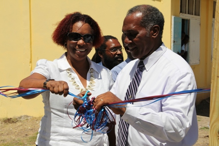 Premier of Nevis Hon. Vance Amory and Representative of the Inter-American Institute for Cooperation on Agriculture (IICA) Offices in the East Caribbean States Mrs. Una May Gordon cut the ribbon to the new green house at the Charlestown Secondary School