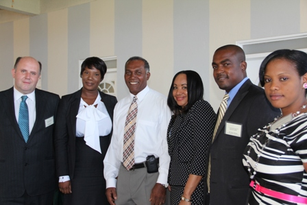 (L-R) Mr. Ernie Dover, Advisor at the Financial Services Regulation Supervision Department Ms. Heidi-Lynn Sutton, Premier of Nevis and Minister of Finance in the Nevis island Administration Hon. Vance Amory, Regulator Ms. Lyndis Wattley, Managing Director of KAM Management Services Ltd. of Antigua Mr. Kem Warner and Registrar, International Insurance Ms. Ameilia Jones