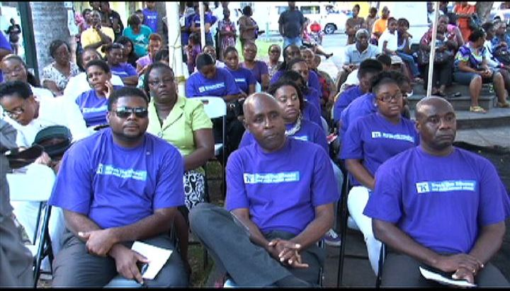 Members of the Nevis Island Cabinet (L-R front row) Hon. Troy Liburd, Cabinet Secretary Mr. Stedmond Tross and Hon. Alexis Jeffers with other Government officials and members of the public at the Child Abuse and Gender-Based Violence Rally at the Memorial Square in Charlestown on April 17, 2013