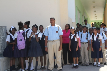 Students of the Charlestown Secondary School on Nevis witness the handing over of a green house to the school from the Inter- American Institute for Cooperation on Agriculture