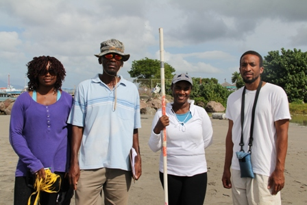 (l-r) Physical Planning Officer in the Department of Planning Thema Ward, Environmental Specialist Lemuel Pemberton, Environmental Officer Claudia Walwyn and Geographic Information Systems Officer Joel Williams participate in the Beach Profiling Project at Gallows Bay on October 30, 2013