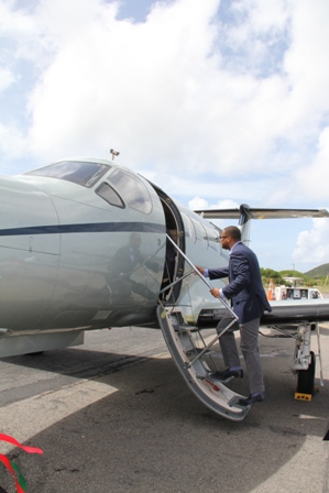 Deputy Premier and Minister of Tourism Hon. Mark Brantley taking a look at an aircraft from Tradewind Aviation's fleet on the tarmac of the Vance W. Amory International Airport on November 02, 2013