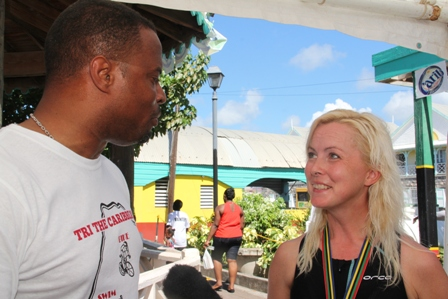 Deputy Premier of Nevis and Minister of Tourism and Sports Hon. Mark Brantley with Ms. Pam Challen United Kingdom winner of a trip to Nevis sponsored by Chain Reaction Cycles in collaboration with Nisbet Plantation Inn, the St. Kitts and Nevis Triathlon Federation and the Nevis Tourism Authority