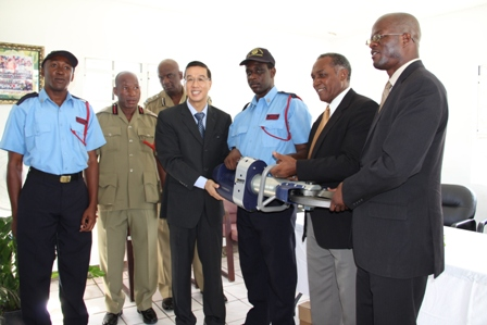 Resident Ambassador for the Federation from the Republic of China/Taiwan His Excellency Li-Jey Tsao presents the pair of Jaws of Life to the St. Kitts and Nevis Fire and Rescue Services on Nevis. Also present at the handing over ceremony was Chief Fire Officer Hester Rawlins (second from left), Assistant Commissioner of Police Robert Liburd (third from left), Premier of Nevis Hon. Vance Amory (second from right) and Federal Minister of Foreign Affairs and Homeland Security Hon. Patrice Nisbett
