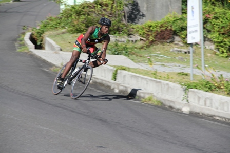 Nevisian Triathlete Romel Gaskin zooming down Zion Hill while cycling round the island of Nevis during the 60k bike segment of the MaccaX Nevis International Triathlon on November 16, 2013