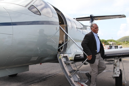 Premier of Nevis Hon. Vance Amory alights from an aircraft at a ceremony at the Vance Amory International Airport in Newcastle, to mark the inaugural launch of Tradewind Aviation's daily nonstop services from San Juan, Puerto Rico to Nevis