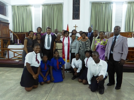 Newly ordained Methodist Minister Reverend Amica Liburd with a contingent of family, friends and well wishers who travelled to Guyana to witness her ordination at the Kingston Methodist Church in Georgetown Guyana on December 08, 2013(Photo by Laurence Richards)