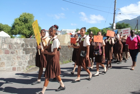 Students of the Gingerland Secondary School march in observance of World AIDS Day 2013