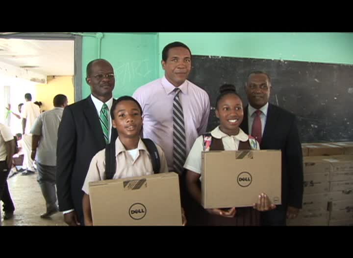 First and Second Form students at the Gingerland Secondary School with computers from the Federal Government's One to One Laptop Programme on November with (back row l-r) Federal Ministers Hon. Patrice Nisbett and Hon. Glen Phillip and Premier of Nevis and Minister of Education Hon. Vance Amory